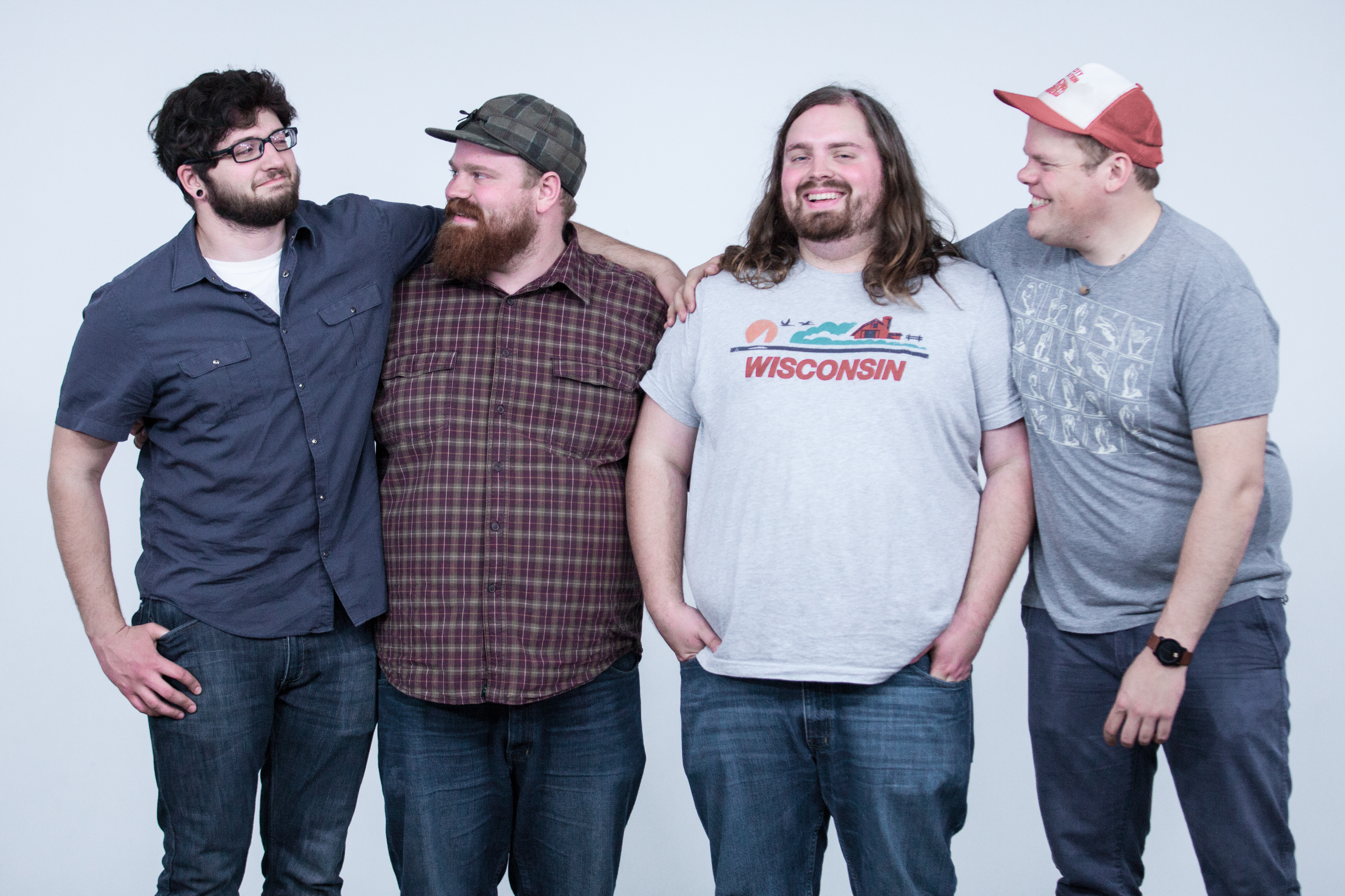 Them Coulee Boys, smile at each other posing at The White Wall studio