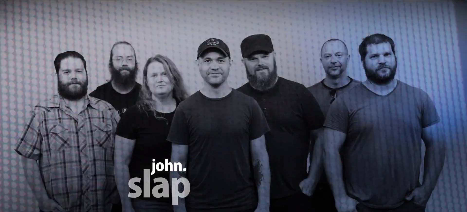 Sioux Falls' super group John.Slap stand in a line at the White Wall Sessions